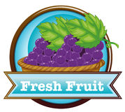 A fresh fruit label with a basket of grapes Royalty Free Stock Photos