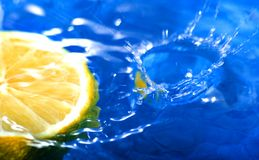 Fresh fruit, lemon. Lemon fruit on the water and a drop falling Stock Photo
