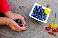 Fresh fruit in little children´s arm Royalty Free Stock Images
