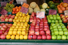 Fresh fruit  at local open air farmers market. Assortment of farm fresh apples and assorted fruit at open air farmers market stock image