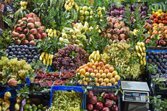 Fresh Fruit Market Stand. Loaded with fruits! Banana, grapes, apples, plums, peaches, and more! What a bounty from nature! Good food and good for you Royalty Free Stock Photos