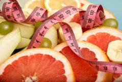 Fresh fruit with measuring tape Stock Photo
