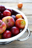 Fresh fruit in a metal colander Royalty Free Stock Photos