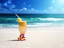 Fresh fruit mix of juices on a beach royalty free stock photography