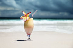 Fresh fruit mix of juices on a beach Stock Image