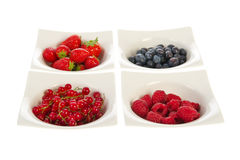 Fresh fruit in modern white bowls Stock Photography