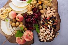 Fresh fruit and nut platter royalty free stock photos