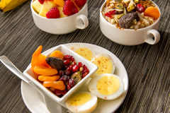 Fresh fruit and oatmeal with healthy toppings for breakfast Stock Photo