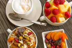 Fresh fruit and oatmeal with healthy toppings for breakfast Stock Images