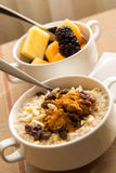 Fresh fruit and oatmeal with healthy toppings for breakfast Royalty Free Stock Photo
