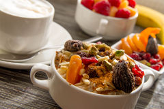 Fresh fruit and oatmeal with healthy toppings for breakfast Royalty Free Stock Photography