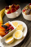 Fresh fruit and oatmeal with healthy toppings for breakfast Stock Photos