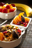 Fresh fruit and oatmeal with healthy toppings for breakfast Royalty Free Stock Images