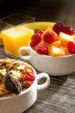 Fresh fruit and oatmeal with healthy toppings for breakfast Stock Photography