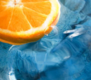 Fresh fruit, orange. Orange fruit on the water with blue background Stock Images