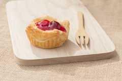 Fresh fruit pie tart with cherry. That serve on wood block (capture with natural light royalty free stock photography