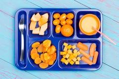 Fresh fruit pieces on blue tray Stock Image