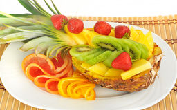 Fresh fruit - pineapple, strawberries, kiwi, grapefruit, orange. Royalty Free Stock Image