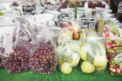 Fresh fruit in plastic bags on the market. Nature Stock Photos