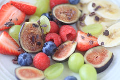 Fresh fruit plate with figs and berries Stock Image
