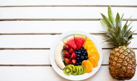 Set of summer. Fresh fruit plate and pineapple, top view from above Stock Images