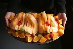 Fresh fruit platter. Being served Royalty Free Stock Photography