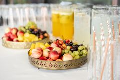 Fresh Fruit platter buffet at business or wedding event venue. Self service or all you can eat - cherries, nectarine. Grapes and pineapple stock photography