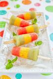 Fresh fruit popsicles with strawberry, mango, peach and kiwi. Homemade pureed fresh fruit popsicles with strawberry, mango, peach and kiwi Stock Photos