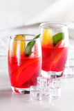 Fresh fruit punch with orange slice and ice cube for refreshment Stock Images