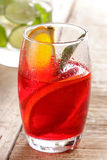 Fresh fruit punch with orange slice for refreshment. Portrait of fresh fruit punch with orange slice for refreshment on wooden background Stock Image