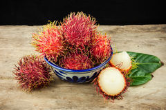 Fresh fruit rambutan on wood background from thailand.  Royalty Free Stock Photo