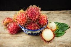 Fresh fruit rambutan on wood background from thailand Royalty Free Stock Image