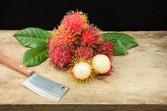 Fresh fruit rambutan on wood background from thailand and a knif. E Royalty Free Stock Image