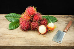 Fresh fruit rambutan on wood background from thailand and a knife.  Stock Image