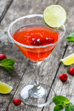 Fresh fruit raspberries cocktail with lime in glass on wooden background. Summer drinks and alcoholic cocktails.  Stock Image