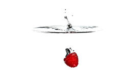 Fresh Fruit. Raspberry falling into clear water Royalty Free Stock Photos