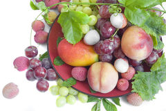 Fresh fruit on a red plate Royalty Free Stock Photo