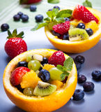 Fresh fruit salad. Fruit salad in orange peel Stock Image