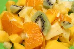 Fresh fruit salad. Closeup of fresh fruit salad with slices of orange and kiwi fruit Royalty Free Stock Photo