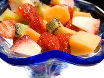 Fresh fruit salad. Served in a blue glass cup Royalty Free Stock Photos
