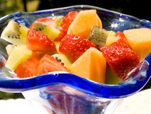 Fresh fruit salad. Served in a blue glass cup Stock Images