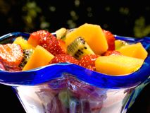 Fresh fruit salad. Served in a blue glass cup Stock Photo