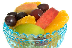 Fresh Fruit Salad in a Blue Glass Desert Bowl Royalty Free Stock Photos