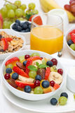 Fresh fruit salad and cream for breakfast, vertical. Close-up Stock Image