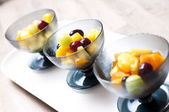 Fresh fruit salad in cups. Shallow focus Royalty Free Stock Photos