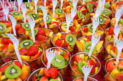 Fresh fruit salad cups. Mixed fresh fruit salad cups for sale in a street market, London, UK Stock Image