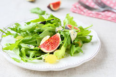 Fresh fruit salad with figs and cheese. Food close up Stock Photo