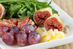 Fresh fruit salad with figs and cured ham. Fruit salad with figs and cured ham Royalty Free Stock Photos