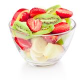 Fresh fruit salad in glass bowl isolated on white background royalty free stock image