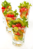 Fresh fruit salad in glasses Stock Photos